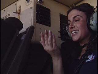 13 News Reporter Marissa Alter wipes the sweat from her brow during the Fat Albert ride.