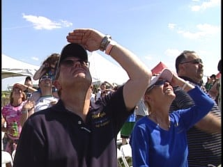 """Major Hess's parents, Bob and Kathy Hess, watch the """"Fat Albert"""" fly overhead."""
