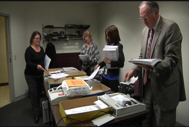 Winnebago County employees check voting machines