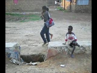 Kids walking in town of Waku Kunga.