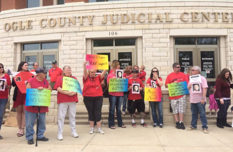 Protesters gather outside the Ogle County Judicial Center. They are friends and family members of Megan Wells.