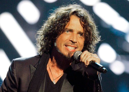 (AP Photo/Jeff Christensen, File). FILE - In this Sept. 5, 2008, file photo, musician Chris Cornell performs on stage during Conde Nast's Fashion Rocks show in New York.