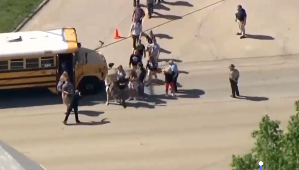 Ariel view showing students being loaded onto a bus.