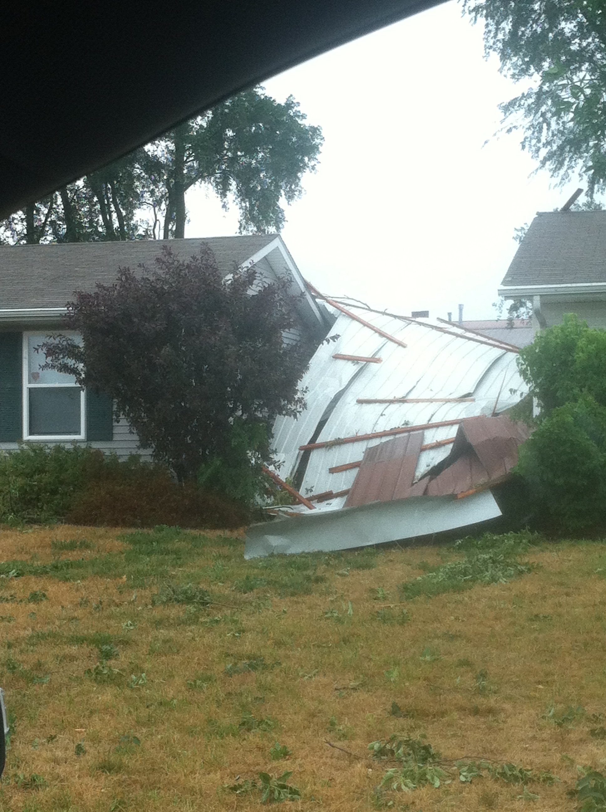 Roof damage in South Beloit - Photo Courtesy: Erinn Brown
