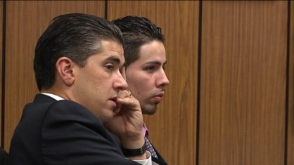 Ricardo Jaimes (right) sits next to his lawyer listening to the verdict.