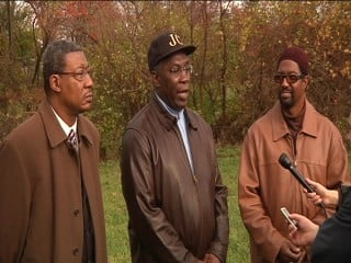 Pastor Kenneth Bell (middle) and Lloyd Johnston speak out.