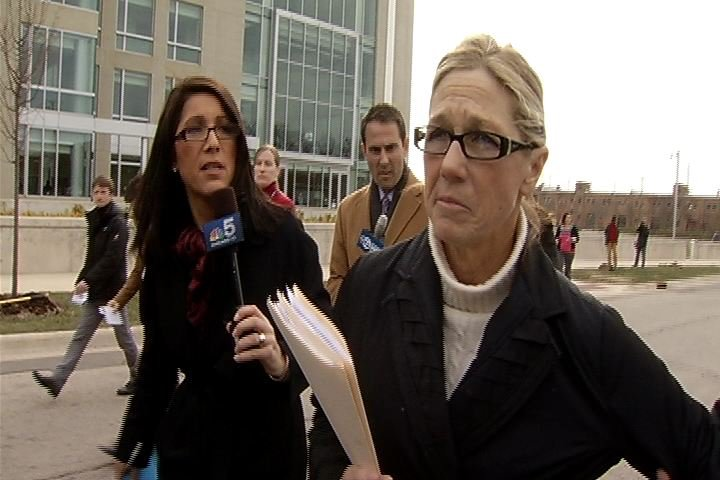 Rita Crundwell walks away from reporters after she pleads guilty.