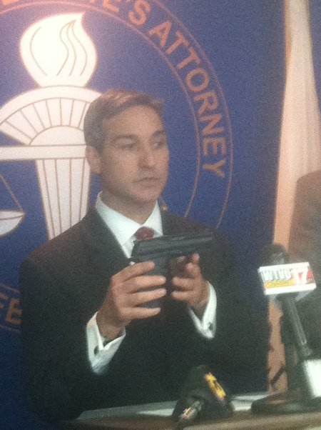 Bruscato holds up the same make and model of pellet gun used by Bell (but not the same gun) at the press conference.