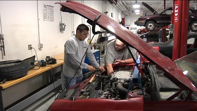 RVC students work on car in Automotive Program Lab.