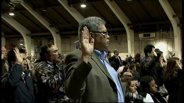 Group of new American citizens take the citizenship oath.