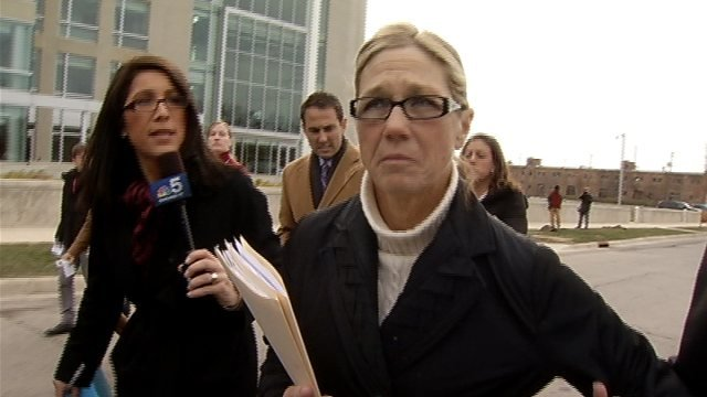 (File photo) Rita Crundwell walks away from reporters after she pleads guilty.