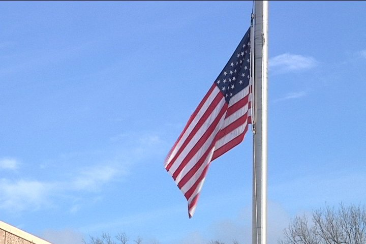 Flags lowered to half staff across Rockford to mourn Robertson's passing
