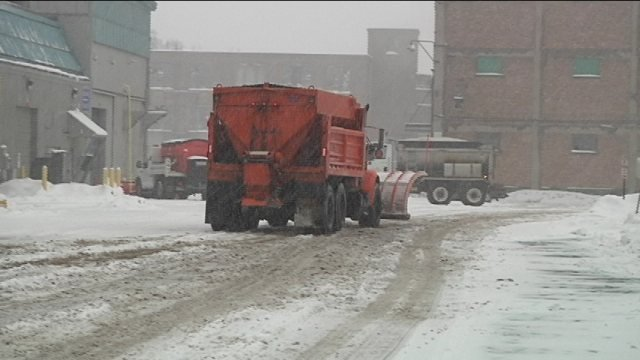 Plow returns to Rockford City Yards to refill salt.