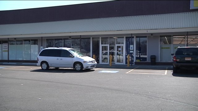 Driver looks for opening date on Auburn St. facility.