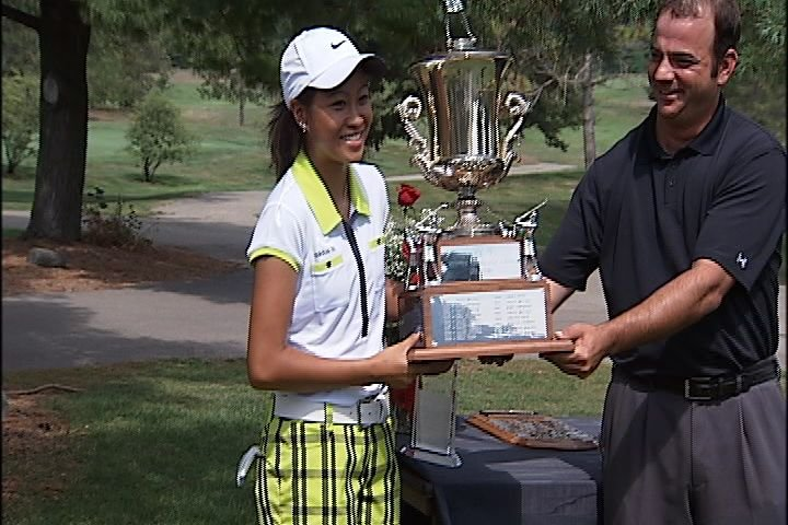 Defending Rockford Women's City Classic champ Cynthia Bounleutay receiving last year's trophy.