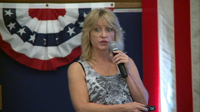 Mary Marshall, founder and director of The Paranormal MD, a paranormal investigation group, speaks at conference.