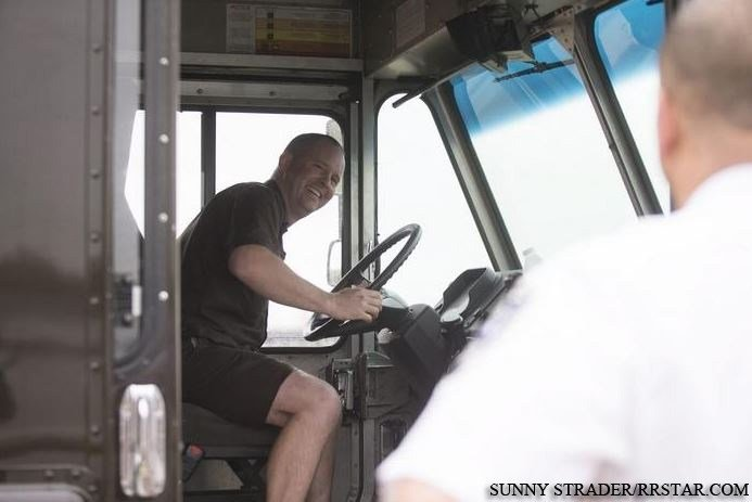 Jeff Hermansen heads back on his UPS driving route after rescuing a man who jumped into the Rock River Tuesday, May 5, 2015, near the 100 block of W. State Street. SUNNY STRADER/RRSTAR.COM