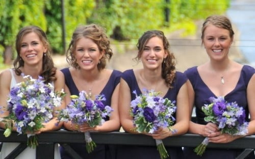 Jeannie surrounded by her two sisters and another bridesmaid at her sister's wedding.