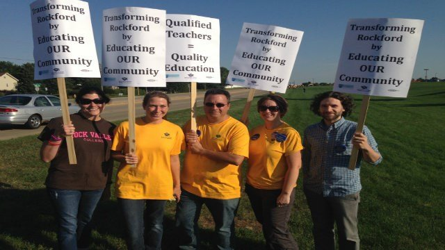 Picketers holding signs at RVC teachers' strike.