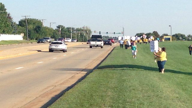 Teachers line the road near the entrance to RVC