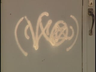 Police have not yet identified all the graffiti symbols on the door.