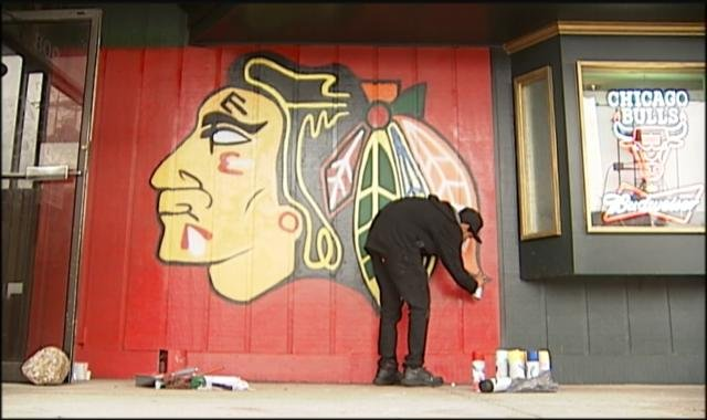 Local artist paints blackhawks mural wkow 27 madison for Blackhawks mural chicago